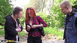 Two guys seduced and fucked a long-legged redhead slut