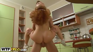 Flexible and artistic redhead pounded hard in the kitchen